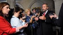 NDP Leader Tom Mulcair speaks to reporters in the Foyer of the House of Commons following Question Period on Parliament Hill in Parliament Hill in Ottawa on Monday, September 17, 2012. (Sean Kilpatrick/THE CANADIAN PRESS)