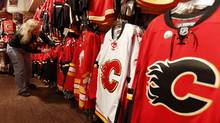 Debbie Chadwick manager of the Calgary Flames FanAttic store organizes the Flames jerseys (Globe and Mail/Todd Korol)