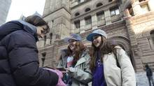 Karen Phillips, left, accompanied her daughter Natalie, 14, centre, and her friend Emily McEwan, 14, to Old City Hall courthouse in Toronto March 10 2014 where a hearing was held into pop star Justin Bieber's assault case. Bieber was not in court, much to the dismay of the fans who gathered and watched the very brief judicial proceeding. The two, accompanied by Natalie's mom, made the trip from Port Perry by GO train in the hopes that Bieber might make a surprise appearance. (Fred Lum/Fred Lum/The Globe and Mail)