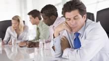 Many meetings waste time and are unproductive. (Monkey Business Images Ltd./Thinkstock)