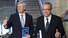 Prime Minister Stephen Harper (left) stands with Finance Minister Joe Oliver as he arrives to table the budget on Parliament Hill in Ottawa on Tuesday, April 21, 2015. While a conservative minority of economists supports the government's balanced-budget approach, a broader consensus of experts believe that running a modest deficit over the next couple of years, with the money going to any or all of the above, would be the wiser approach. (Justin Tang/The Canadian Press)