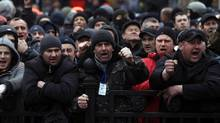 Anti-government protesters shout slogans in front of Ukraine's parliament in Kiev, Ukraine, Saturday, Feb. 22. (Marko Drobnjakovic/Associated Press)