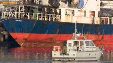 Migrants look over the side of the MV Sun Sea in Colwood, B.C., on Aug. 13, 2010. (Jonathan Hayward/THE CANADIAN PRESS)