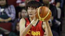 China's Wei Wei (18) looks for room to pass in the first half of an exhibition women's basketball game, Saturday, May 12, 2012, in Seattle. (Elaine Thompson/AP/Elaine Thompson/AP)