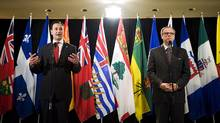 P.E.I. Premier Robert Ghiz, left and Saskatchewan Premier Brad Wall speak at a press conference to discuss health care innovation in Canada in Toronto on Friday, June 1, 2012. (Aaron Vincent Elkaim/The Canadian Press/Aaron Vincent Elkaim/The Canadian Press)