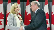 Prime Minister Paul Martin welcomes Tory defector Belinda Stronach to the Liberal at a news conference in Ottawa on May 17, 2005. (CHRIS WATTIE/Chris Wattie/Reuters)