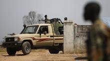 SPLA soldiers drive in a vehicle in Juba on Dec. 21, 2013. Canada's Foreign Affairs department is urging all Canadian in South Sudan to leave immediately. (GORAN TOMASEVIC/REUTERS)