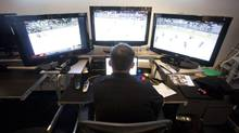An NHL official watches game action in the league's video review room in Toronto Monday, November 29, 2010. (Darren Calabrese/THE CANADIAN PRESS)