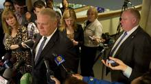 Councillor Doug Ford, left and his brother Mayor Rob Ford are seen at city hall in Toronto on Thursday February 20, 2014. Doug announced that he will not make a run for provincial politics. (Kevin Van Paassen/The Globe and Mail)