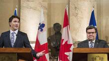 Montreal Mayor Denis Coderre, right, looks on as Prime Minister Justin Trudeau speaks during a press conference in Montreal on Tuesday, Jan. 26, 2016. Mr. Coderre received near-universal condemnation from Canadian politicians for his rejection of the Energy East pipeline project. (Graham Hughes/THE CANADIAN PRESS)