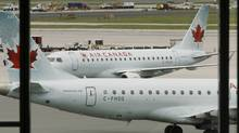 Air Canada planes sit on the tarmac at Pearson International Airport in Toronto. (MIKE CASSESE/REUTERS)