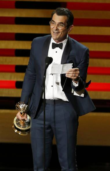 "Ty Burrell accepts the award for Outstanding Supporting Actor In A Comedy Series for his role in ""Modern Family"" during the 66th Primetime Emmy Awards in Los Angeles, California August 25, 2014. (MARIO ANZUONI/REUTERS)"
