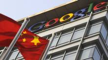 A Chinese flag flies over the company logo outside the Google China headquarters in Beijing on January 14, 2010. (LIU JIN/LIU JIN/AFP/Getty Images)