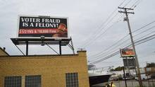 A billboard located at the intersection of Triskett and Lorain, in Cleveland, Ohio's west side is pictured October 14, 2012. Legal and labour activists and community members said the signs deliberately target and seek to intimidate blacks and Hispanics, other minorities and the poor - as well as ex-convicts - groups key to Democrats' campaign voter drives ahead of the vote. (TYLER BEHM/REUTERS)