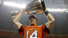 BC Lions quarterback Travis Lulay holds the Grey Cup after the Lions defeated the Winnipeg Blue Bombers to win the CFL's 99th Grey Cup football game in Vancouver, British Columbia, November 27, 2011. (MARK BLINCH/REUTERS)