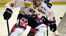 'It's a good team with high expectations and the support here is pretty incredible. It's hard to beat,' New York Islanders centre John Tavares, bottom, says of playing for SC Bern in the Swiss National League A. His sentiments are echoed by other locked-out NHL players. (Sigi Tischler/AP)