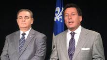 Jacques Duchesneau (left), the head of Quebec's anti-collusion unit, and Quebec Transport Minister Pierre Moreau meet reporters in Montreal. (Peter Ray/THE CANADIAN PRESS)