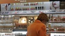 A woman checks out merchandise at L'Oreal cosmetics in a shop in Riga. (INTS KALNINS/REUTERS)