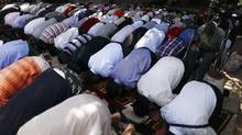 People attend Friday prayers in Tunis on June 15, 2012. (ZOHRA BENSEMRA/REUTERS)