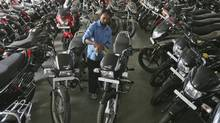 A study by Wrangler in India found most people travel by two-wheelers in the country, as opposed to their American counterparts, who drive cars. (MUKESH GUPTA/REUTERS)