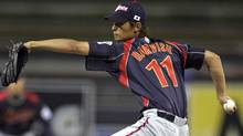 In this March 17, 2009 file photo, Japan's starter Yu Darvish pitches against South Korea in the first inning of their World Baseball Classic game in San Diego. (Chris Park/AP/Chris Park/AP)