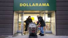 Shares of Dollarama Inc. gained 4 per cent after the discount retail announced it was raising its dividend and said quarterly profit soared 40 per cent on sales growth of 15 per cent. Customers shop at the Dollarama discount store location at Spadina Ave and Adelaide St. West in Toronto, Ont. Dec. 7/2011. (Kevin Van Paassen/Kevin Van Paassen/The Globe and Mail)