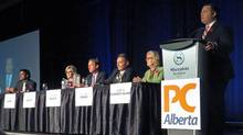 Former Conservative MP Jason Kenney speaks to 1,100 members in the first Alberta Progressive Conservative party leadership forum while the other five leadership candidates, Stephen Khan, left to right, Sandra Jansen, Byron Nelson, Richard Starke and Donna Kennedy Glans listen in Red Deer, Alta. on Nov. 5, 2016. (Dean Bennett/The Canadian Press)