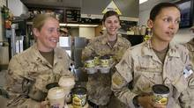 Canadian Forces Lt. Rebecca Evans, left, from Toronto, Capt. Jane Sparkes, from Edmonton, and Capt. Aida Gabriel, from Toronto, load up on iced cappuccino from Tim Horton's at the base in Kandahar, Afghanistan Friday, April 27, 2007. (Ryan Remiorz/CP)