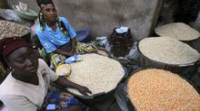 Women selling grains wait for customers at the Bodija market in Ibadan, southwest Nigeria (AKINTUNDE AKINLEYE)