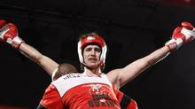 Justin Trudeau celebrates after defeating Conservative Senator Patrick Brazeau in a charity boxing match for cancer research, Saturday, March 31, 2012 in Ottawa. The Prime Minister has gotten in on the April Fools' Day spirit with a lighthearted tweet aimed at former Friends star – and classmate – Matthew Perry. (FRED CHARTRAND/THE CANADIAN PRESS)