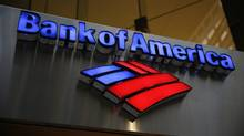 FILE - This Tuesday, Jan. 14, 2014 file photo shows a Bank of America sign in Philadelphia. Bank of America Corp. reports quarterly financial results on Wednesday, July 16, 2014. (AP Photo/Matt Rourke, File)