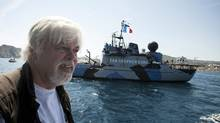 President of the Sea Shepherd Conservation Society, Paul Watson, answers questions while sailing aboard a trimaran off the harbor of La Ciotat, southern France, May 25, 2011. On background is the Sea Shepherd vessel : Steve Irwin. (Patrick Gherdoussi/THE CANADIAN PRESS/ AP)