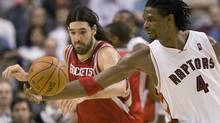 Toronto Raptors forward Chris Bosh, right, and Houston Rockets forward Luis Scola chase down a loose ball during second half NBA action in Toronto on December 13, 2009. Bosh scored 27 points as the Raptors won 101-88. (FRANK GUNN)