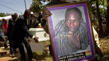 A members of the Ugandan gay community carries a picture of murdered gay activist David Kato during his funeral near Mataba, on January 28, 2011. (MARC HOFER/Marc Hofer/AFP/Getty Images)