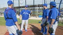 Toronto Blue Jays catchers J.P. Arencibia, Josh Thole and Henry Blanco talk to manager John Gibbons before infield drills at the team's MLB baseball spring training facility in Dunedin, Florida February 21, 2013. (FRED THORNHILL/REUTERS)