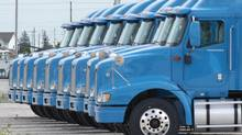In this Sept. 4, 2003 file photo, trucks sit in the yard of the Navistar International Truck plant in Chatham, Ontario. (JASON KRYK/THE GLOBE AND MAIL)