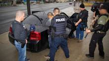 In an undated handout photo, Immigration and Customs Enforcement officers detain a suspect in Los Angeles in February of 2017. With an executive order last month and a pair of Department of Homeland Security memos on Feb. 22, the Trump administration has significantly hardened the country's policies regarding illegal immigration. (U.S. Immigration and Customs Enforcement/NYT)