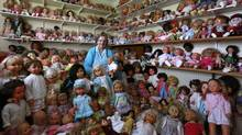 After three decades of collecting, Mary Hickey, 93, of Ashbourne, Ireland, owns more than 420 dolls. (CATHAL MCNAUGHTON/REUTERS)