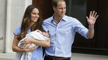Prince William, right, and Kate, Duchess of Cambridge, hold the Prince of Cambridge, Tuesday July 23, 2013, as they pose for photographers outside St. Mary's Hospital exclusive Lindo Wing in London where the Duchess gave birth on Monday, July 22. (Kirsty Wigglesworth/Associated Press)