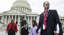 Zombies have taken over Capitol Hill? Okay, it's just a promotional stunt for a theatrical haunted house but, even so, the world is whata Tabatha Southey describes as 'one big Nervous Nelly right now,' awaiting the results of the U.S. election. (Bill Clark/Getty Images/CQ-Roll Call Inc.)