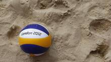 A London 2012 beach volleyball lies on the sand following a training session at the London 2012 Olympics beach volleyball venue in central London July 19, 2012. (SUZANNE PLUNKETT/REUTERS)