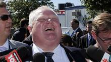 Toronto mayor Rob Ford laughs as her answers questions from journalists attending the groundbreaking ceremony for the Pan Am Games Aquatic Centre in Scarborough, Ontario September 27, 2012 (Fernando Morales/The Globe and Mail)