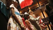A citizenship ceremony at Toronto's Harbour Front Centre on Canada Day, July 1, 2013. (Gloria Nieto/The Globe and Mail)