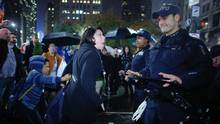 A woman argues with NYPD officers as she takes part in a protest against president-elect Donald Trump in New York on Wednesday. (KENA BETANCUR/AFP/Getty Images)