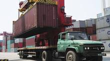 A crane loads a container onto a truck at a port in Qingdao, Shandong province, in May. A joint Canadian and Chinese government economic study released Wednesday identifies the potential gains from deeper trade and investment. (CHINA DAILY/REUTERS)