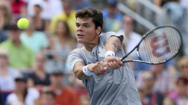 Canada's Milos Raonic hits a return to compatriot Vasek Pospisil during the men's Rogers Cup semi-finals tennis tournament match in Montreal August 10, 2013. (CHRISTINNE MUSCHI/REUTERS)