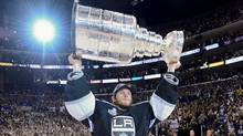 Los Angeles Kings goalie Jonathan Quick holds up the Stanley Cup after the Kings beat the New Jersey Devils 6-1during Game 6 of the NHL hockey Stanley Cup finals, Monday, June 11, 2012, in Los Angeles. (Mark J. Terrill/AP)