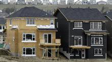 Homes under construction are seen in this file photo. Statscan said Monday that the value of building permits rose 4.5 per cent in May. (Jeff McIntosh/The Globe and Mail)