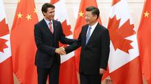 Chinese President Xi Jinping (R) shakes hands with Canadian Premier Justin Trudeau ahead of their meeting at the Diaoyutai State Guesthouse in Beijing, China, 31 August 2016. (Pool/Getty Images)