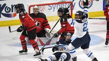 Finland's Noora Tulus (24) and Emma Nuutinen (22) celebrate the winning goal over Canada in the IIHF Ice Hockey Women's World Championship preliminary round game in Plymouth, Mich., on Saturday, April 1, 2017. (Jason Kryk/THE CANADIAN PRESS)